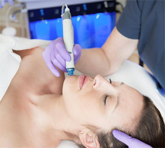 Patient receives HydraFacial treatment.